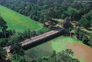 The moat of Angkor Thom, crossed by 108 powerful figures (54 each side) pulling gigantic Nagas in order to 'Churn the Milky Ocean'.