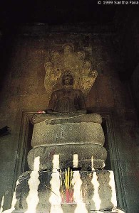 The Buddha resting on the coils of the Naga serpent Mucalinda, who sheltered the Buddha from a week long rainstorm by enfolding him in his coils - from Angkor Wat.