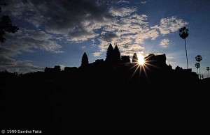 The towers of Angkor Wat playing with the sun at dawn.