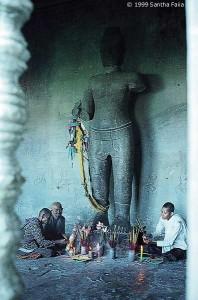 Cambodian Nuns at the feet of a statue of Vishnu.