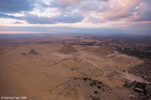 The Pyramids and the Great Sphinx of Giza. The Sphinx faces perfectly due east. The pyramids are oriented precisely, with each face aligned to a cardinal direction.