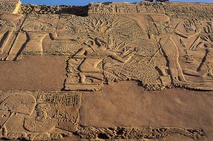 Ibis-headed Thoth records the name of Pharaoh Seti 1 on the tree of life on this scene from Karnak