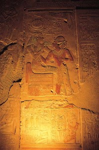 Seti 1 temple, Abydos: Isis, goddess of magic, offers ankh, the gift of eternal life, to the soul of Pharaoh Seti 1.