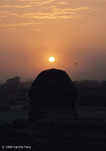 The head of the Great Sphinx, viewed in silhouette from the rear, gazing at the rising sun at dawn on the spring equinox.