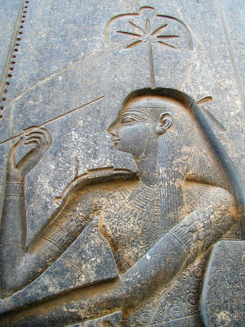 Ancient Egyptian Seshat, commonly known as the goddess of wisdom and writing, depicted on the throne of Rameses II, Luxor Temple, Egypt.